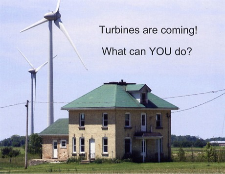 turbines overlooking homes